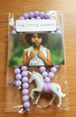 The Little Vikings grey unicorn with lilac beads necklace