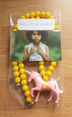 The Little Vikings pink unicorn with yellow beads necklace